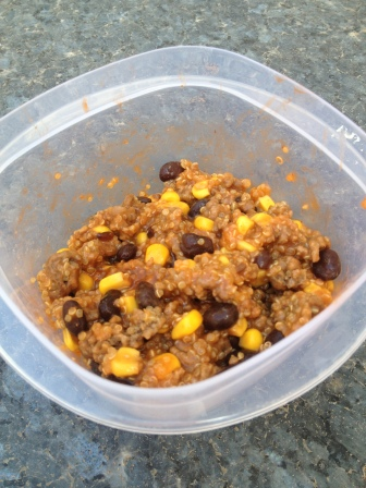 ground beef, quinoa, corn, and black beans with dressing on top.